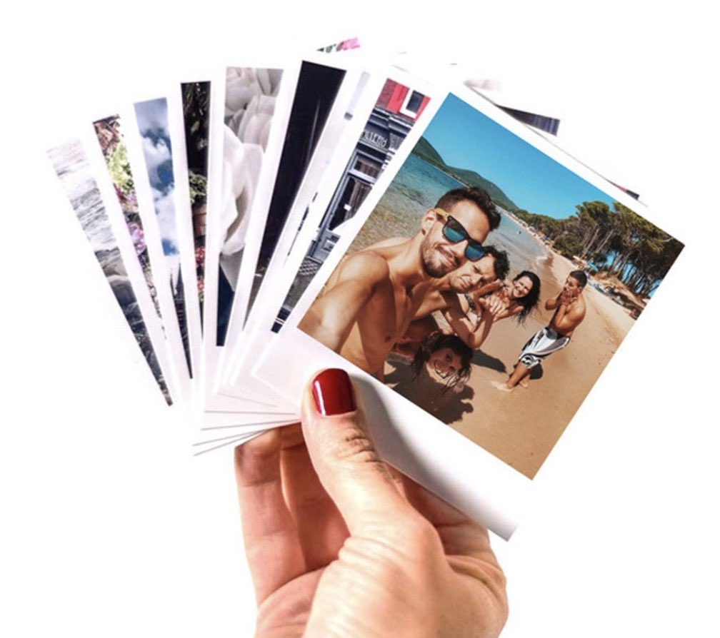 polaroid prints in hand